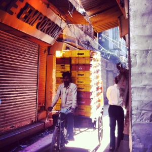 The narrow lanes and the early morning sunshine piercing through the old cobbled buildings, the beginning of a chaotic day...